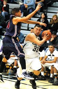 Capital Jaguar's Michael Lopez, #33, goes  for the layup while  Deming Wildcat's Richard Regalado, #24, tries to defend during their game  at Edward A. Ortiz Memorial Gymnasium on Saturday, March 3, 2012. Capital won 47-43.  Photos by Jane Phillips/The New Mexican