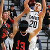 State Basketball Tournament. Capital v. Albuquerque Academy : Opening round action. Game won by No. 7 Capital 55-46.