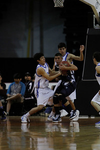 St. Mike's Kameron Romero, number 12, and Salomon Martinez, number 32, double team Silver's Adam Kesler, number 1, during the second quarter of the Silver vs St. Mike's at the Santa Ana Star Center in Rio Rancho during the Basketball State Championship on Mar. 7, 2012.  Photo by Luis Sanchez Saturno/The New Mexican