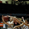 Santa Fe Indian School's Jasmine Felipe, number 22, and Makayela Holiday, number 32, and Portales' Savannah Vincent, number, 33, try to get a rebound during the first quarter of the Santa Fe Indian School vs Portales at The Pit in Albuquerque during the Basketball State Championship on Mar. 8, 2012.<br /> <br /> Photo by Luis Sanchez Saturno/The New Mexican