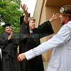 Mary E. Angell, Registar, congratulates John M O'Connor, Bachelor of Arts, Moving Image Arts at the  Santa Fe University for Art and Design Commencement  on Saturday, May 12, 2012.  <br /> <br /> <br /> Photos by Jane Phillips/The New Mexican