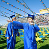 Kylun Wyatt Stanfield-Boza, 18, salutes the crowd as he walks to his graduation at Santa Fe High on Wednesday, May 23, 2012.<br /> <br /> Photos by jane Phillips/The New Mexican