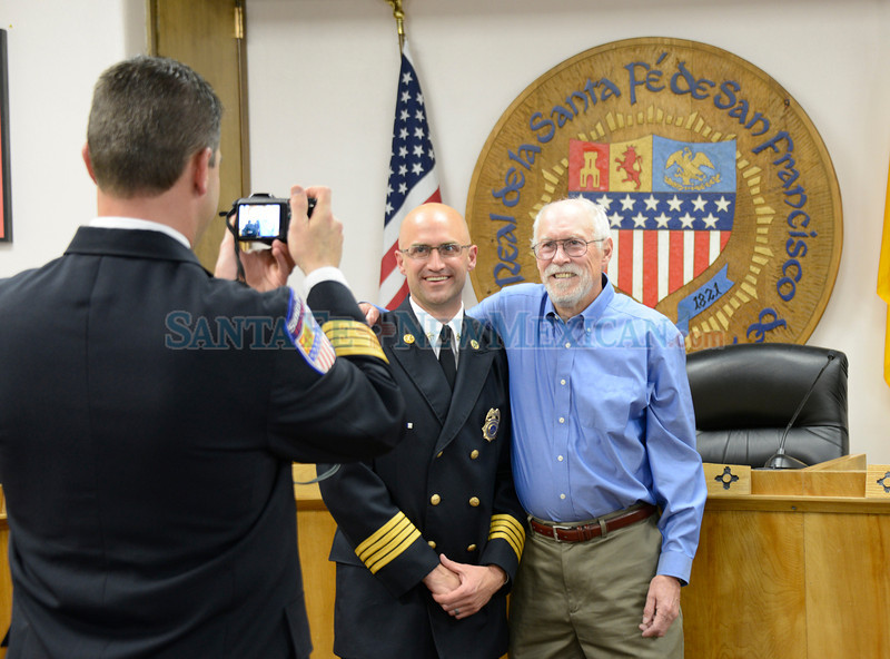 The City of Santa Fe swearing ceremony for Erik J. Litzenberg as its new Fire Chief, in the Santa Fe, New Mexico City Council Chambers on Thursday, May 23, 2013. Clyde Mueller/The New Mexican