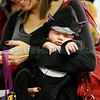 Isaiah Mendez, 3 weeks, from Santa Fe, sleeps through his first Halloween in his mother's arms, Alma Perez, from Santa Fe, at the Halloween Fall Festival at the Santa Fe Community College on Oct, 31, 2011.<br /> <br /> Photo by Luis Sánchez Saturno/The New Mexican