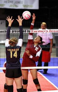 Santa Fe Indian School Jasmine Felipe, #10 volleys with Ruidoso High School Hannah Lindsey #14 at Santa Ana Star on Thursday, November 10, 2011. Photos by Jane Phillips/The New Mexican