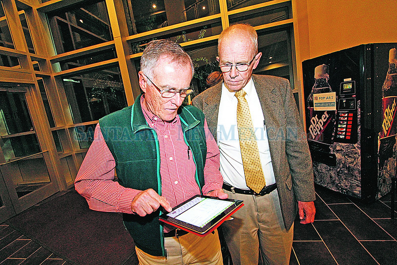 Robert Gibson, left, from Los Alamos, checks on the latests results with Jim Hall, candidate for the New Mexico House of Representatives in District 43, at the Justice Center in Los Alamos on Tuesday, November 6, 2012. Photo by Luis Sánchez Saturno/The New Mexican