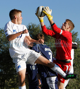 Santa Fe Prep goal keeper, Danny Quinn, picks the ball out of the air before Jackson Baca (left), of St. Michael's High School, can get his head on it during a boys soccer game in Santa Fe, N.M. on Oct. 10, 2011. Natalie Guillén/The New Mexican