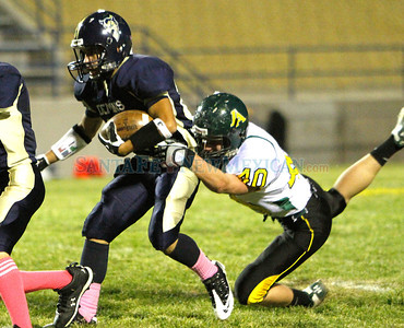 (right) Corey Geyer (#40), of Los Alamos brings down Moses Montoya (#82), of Santa Fe High, during the second quarter of a football game in Santa Fe, N.M. on Oct. 14, 2011.  Natalie Guillén/The New Mexican