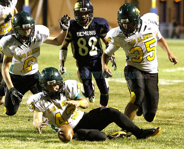 (center) Jared Mang, of Los Alamos, recovers a fumbled ball from Santa Fe High during the third quarter of a football game in Santa Fe, N.M. on Oct. 14, 2011.  Natalie Guillén/The New Mexican