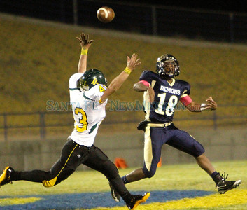 (#18) (right) Jordan Booth-Homer, of Santa Fe High makes a pass over the head of (#43) Jared Mang, of Los Alamos, during the third quarter of a football game in Santa Fe, N.M. on Oct. 14, 2011.  Natalie Guillén/The New Mexican