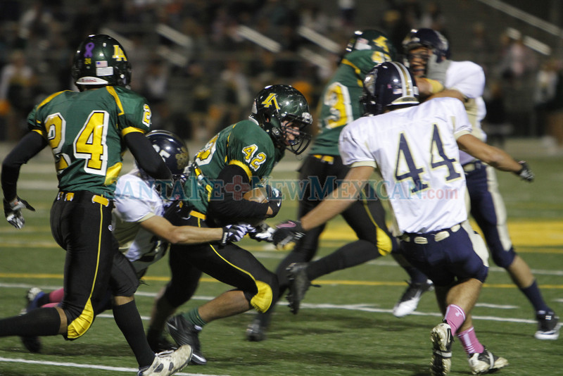 Santa Fe's Christian Gonzales, number 25, tackles Los Alamos' Xavier Dennison, number 42, during the second half of the Los Alamos High School vs Santa Fe High School football game on Friday, October 19, 2012, at Los Alamos. Photo by Luis Sánchez Saturno/The New Mexican