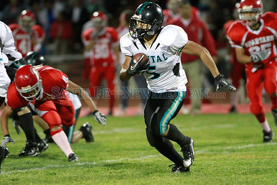 Capital, Angel Lopez, #5, intersepts  the ball from Bernalillo during the second quarter of  their game at Bernaillo High School on Friday, October 21, 2011. At half-time Bernalillo Spartans was up 27-0. Photos by Jane Phillips/The New Mexican