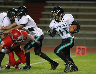 Capital, Derrick Chavez, #11intersepts the ball from Bernalillo during the second quarter of  their game at Bernaillo High School on Friday, October 21, 2011. At half-time Bernalillo Spartans was up 27-0. Photos by Jane Phillips/The New Mexican
