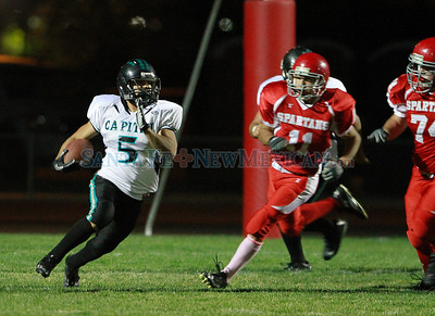 Capital, Angel Lopez, #5, runs with the ball away from Bernalillo during the second quarter of  their game at Bernaillo High School on Friday, October 21, 2011. At half-time Bernalillo Spartans was up 27-0. Photos by Jane Phillips/The New Mexican