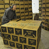 Brother Augustine Seiker stacks cases of Monks' Wit Monks as their beer is bottled at the Sierra Blanca/Rio Grande brewery in Moriarty Wednesday October 19, 2011. <br /> Clyde Mueller/The New Mexican