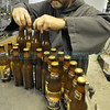 Brother Augustine Seiker moves the bottle to cases as Monks and volunteers from the Abiquiu Christ in the Desert Monastery help as their beer is bottled at the Sierra Blanca/Rio Grande brewery in Moriarty Wednesday October 19, 2011. <br /> Clyde Mueller/The New Mexican