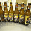 Bottles of Monks' Wit stand ready to be put into cases during the brewery day where Monks and volunteers from the Abiquiu Christ in the Desert Monastery help as their beer is bottled at the Sierra Blanca/Rio Grande brewery in Moriarty Wednesday October 19, 2011. <br /> Clyde Mueller/The New Mexican