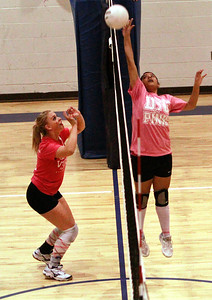 Santa Fe Preparatory senior Aysia Felson defends a tip from Pecos freshman Jeanine Montoya during a District 2AA match Wednesday night in Prep Gymnasium. - Jane Phillips/The New Mexican