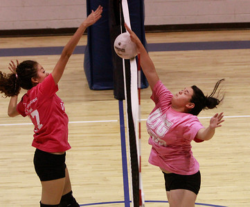 Santa Fe Preparatory senior Dominique Ehrl rises above the net to block a shot by Pecos senior Arlene Quintana during a District 2AA match Wednesday night in Prep Gymnasium. - Jane Phillips/The New Mexican