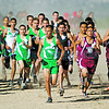 Mora's  Alonzo Chavez, center, tries to take the lead at the start of his race at the Santa Fe Indian School Invitational cross country meet at Cochiti Elementary School on October 6, 2012. Chavez finished in first place. Photo by Luis Sánchez Saturno/The New Mexican