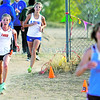 Taos' Haley Rach leads from St. Mike's Jordan Romero to finish 4th and 5th during the Santa Fe Indian School Invitational cross country meet at Cochiti Elementary School on October 6, 2012. Photo by Luis Sánchez Saturno/The New Mexican