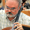 Santa Fe Community Orchestra member Jim Knudson plays the Cello during rehearsal.<br /> Clyde Mueller/The New Mexican