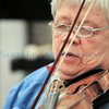Santa Fe Community Orchestra member Steina Vasulka plays the violin during rehearsal.<br /> Clyde Mueller/The New Mexican