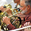Santa Fe Community Orchestra member Paul Pease (foreground) plays the horn during rehearsal.<br /> Clyde Mueller/The New Mexican