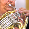 Santa Fe Community Orchestra member Tomi Scott plays the horn during rehearsal.<br /> Clyde Mueller/The New Mexican