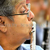 Santa Fe Community Orchestra member Mary Anne Martinez plays the   flute during rehearsal.<br /> Clyde Mueller/The New Mexican