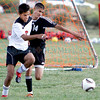 Monte Del Sol's Dakota Lopez, number 2, and Capital's Hector Oquedo, number 14, run after a loose ball during the first half of their soccer match at the Municipal Recreation Complex on Aug. 31, 2010. Capital won 4-1.             Luis Sanchez Saturno/ The New Mexican.