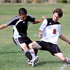 Capital's Juan Sigala, number 2, challenges the ball from Monte Del Sol's Benjamin Clark, number 9, during the first half of their soccer match at the Municipal Recreation Complex on Aug. 31, 2010. Capital won 4-1.             Luis Sanchez Saturno/ The New Mexican.