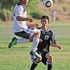 Monte Del Sol's Javier Kordell, number 12, and Capital's Helian Najera, number 17, try to take posession of a goal kick during the second half of their soccer match at the Municipal Recreation Complex on Aug. 31, 2010. Capital won 4-1.             Luis Sanchez Saturno/ The New Mexican.