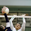 Pojoaque High School's Lindsay Longacre, number 15, goes up to block a spike from Santa Fe's Barbie Robertson, number 6, during the second game of their match at Pojoaque on Sep. 14, 2011. <br /> <br /> Photo by Luis Sánchez Saturno/The New Mexican
