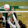 Santa Fe High School's Mary Padilla, number 4, tries to block Pojoaque's Briana Ainsworth, number 3, during the first game of their match at Pojoaque on Sep. 14, 2011. <br /> <br /> Photo by Luis Sánchez Saturno/The New Mexican