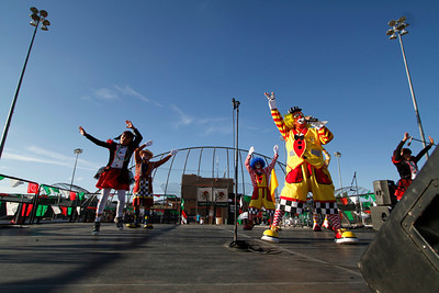 Guillermo Linares, as Platanito, right, with Payashow & Co, entertains the crowd at the Municipal Recreation Complex on Sep. 16, 2011, during the Mexican Independence Day celebration.  The food vendors and entertainment attracted over 2000 people to the celebration.  Photo by Luis Sánchez Saturno/The New Mexican