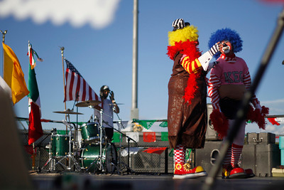Guillermo Linares, as Platanito, left, and Edwin Gonzles, as Gringo Loco, both with Payashow & Co, entertain the crowd at the Municipal Recreation Complex on Sep. 16, 2011, during the Mexican Independence Day celebration.  The food vendors and entertainment attracted over 2000 people to the celebration.  Photo by Luis Sánchez Saturno/The New Mexican