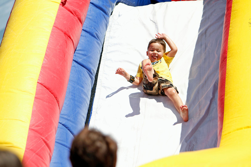 Prescott Scargall, 3, from Santa Fe, slides down one of the slide at the Boys and Girls Club Fun Fair at the Rail Yard Park on Saturday, September 1, 2012. Photo by Luis Sanchez Saturno/The New Mexican