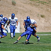 Bloomfield's Dustin Dugger, number 33, gets tackled by Salomon Martinez, number 28, during the second quarter of the St. Michael's High School vs Bloomfield football game at St. Mike's on Saturday, September 1, 2012. Photo by Luis Sánchez Saturno/The New Mexican