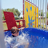 Cruz Prost, 7, from Santa Fe, get dunked at the dunk tank at the Boys and Girls Club Fun Fair at the Rail Yard Park on Saturday, September 1, 2012. Photo by Luis Sanchez Saturno/The New Mexican