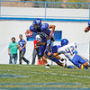 St Mike's Salomon Martinez, number 28, gets past Bloomfield's Adrian Vigil, number 42, during the third quarter of the St. Michael's High School vs Bloomfield football game at St. Mike's on Saturday, September 1, 2012. Photo by Luis Sánchez Saturno/The New Mexican