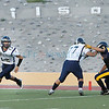Santa Fe High Demons Jason Fitzpatrick, 12, looks to pass the ball during the first quarter of their game against the  Albuquerque HIghlands at Wilson Stadium on Friday, September 3, 2010.  Highlands was up 41-6 near the end of the second quarter.<br /> Photos by Jane Phillips/The New Mexican