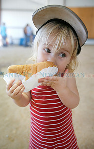 A young girl eats a hot dog at the annual County Fair at the Rodeo grounds  on Friday, August 6, 2010. The fair continues through Sunday, August 8, 2010. Photo by Jane Phillips/The New Mexican
