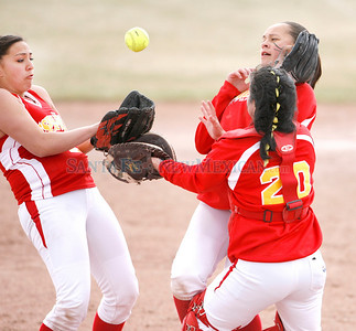 From left, Espa–ola High School, Kayla Romero, #25, Evelyn Cabllero, #6, and Denise Ortiz, #20 all go for a fly ball during the 5th inning of their game against St. Michael's during the Lady Horsemen Invitational semifinals at St.Michael's softball field on Friday, March 26, 2010. Photos by Jane Phillips/The New Mexican