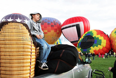 LEDE Steven Carpenter, 5, sits in the basket of his father's balloon, as he watches the 'Flight of The Nations' Mass Ascension during the annual international Balloon Fiesta in Albuquerque, N.M., on Oct. 6, 2010. Steven's dad, Michael Carpenter, has been bringing Steven to the balloon fiesta since he was born, and Carpenter himself has been a pilot for over 20 years.  Natalie Guillen/The New Mexican