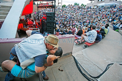 Jack Welch, from Santa Fe, dips Delfin Martinez at the end of one of the songs as Lyle Lovett plays Paolo Soleri in what might be the lat show in the 50-year-old amphitheater on the Santa Fe Indian School campus on July 29, 2010.                   Luis Sanchez Saturno/ The New Mexican.