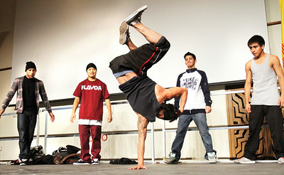"LEDE  Noel Lopez (center) and his dance company ""Harambe,"" perform as ""Beyond 400"" celebrates the city's youth with an array of speeches and artistic presentations in an all-day, youth-oriented symposium at Santa Fe Convention Center on Nov. 22, 2010.     NOTE: (L-R in background) Aaron Hicks, Jon Marc Ha, Dominic Medina, and Jose Lujan.  Natalie Guillen/The New Mexican"