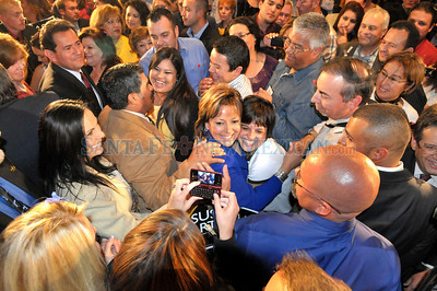 Gov-Eect of New Mexico, Susana Martinez, has her picture taken with one of her supporters at Hotel Encanto de Las Cruces, New Mexico on the evening of Tuesday, November 2, 2010. Clyde Mueller/The New Mexican