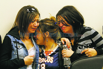 """From left, Monica Gettler, Trisha Valdez and Andrea Suazo console each other during a press conference in Rio Arriba County Sheriff's Office  in Española for their father, Joseph Valdez,47, who was killed """"execution style"""" with Matthew Maestas, 53, on Monday in Hernandez.  Jane Phillips/The New Mexican"""