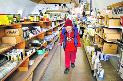 Patty Sahd, 97, used to look out the front window of her family's store in her Sahd's Hardware in Penasco in Northern New Mexico enclave and see women in black shawls walking to church. Sahd, just two years younger than the state itself continues to work at the family store.  Clyde Mueller/The New Mexican
